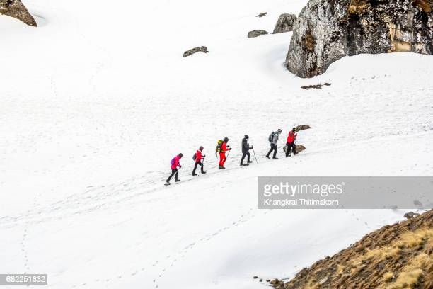 annapurna base camp trekking: walking to the final destination. - annapurna south stock photos and pictures