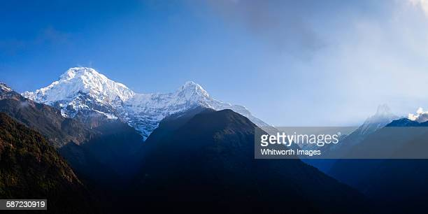 annapurna himalayan view from chomrong nepal - annapurna south stock photos and pictures
