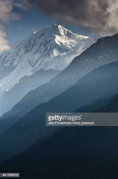 Annapurna III , Himalayas range Mountain nature background landscape cloudy