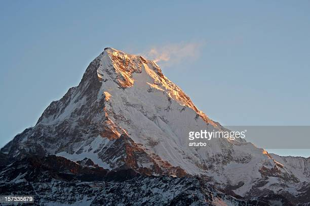 Annapurna mountain peak glowing in very first morning light