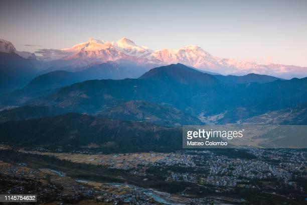 annapurna mountain range at sunset, pokhara, nepal - pokhara stock pictures, royalty-free photos & images
