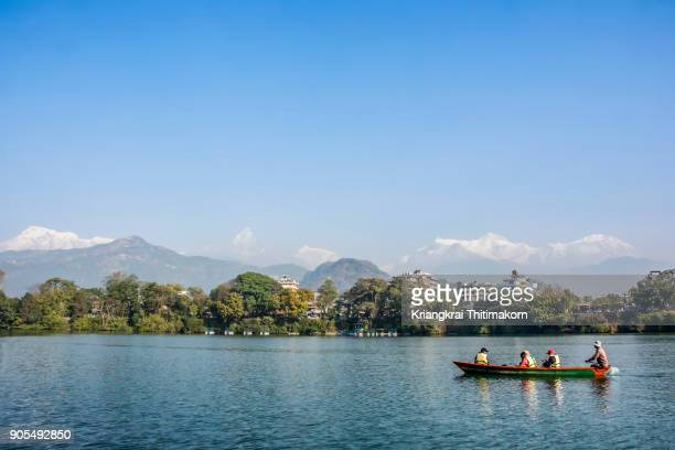 annapurna mountain range from phewa lake, nepal. - pokhara stock pictures, royalty-free photos & images
