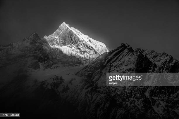 annapurna mountain range on himalayas in nepal - annapurna conservation area stock photos and pictures