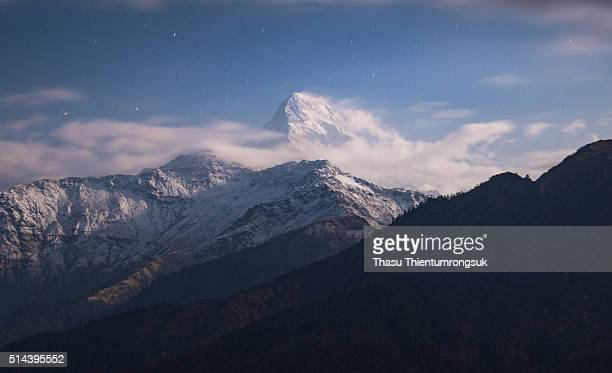 annapurna peak with star - annapurna south stock photos and pictures