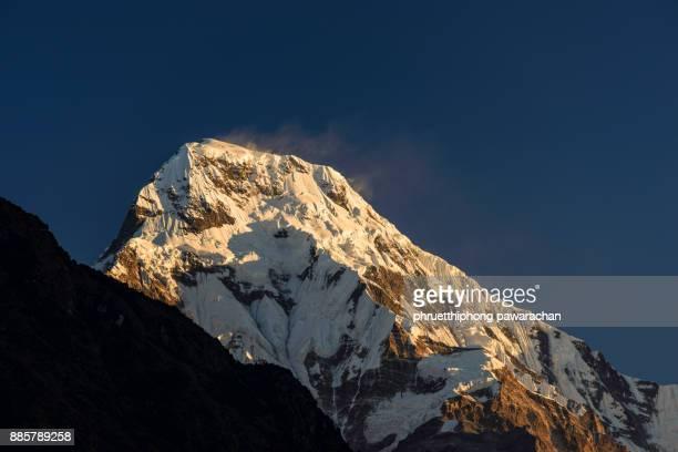 Annapurna South peak during sunrise.
