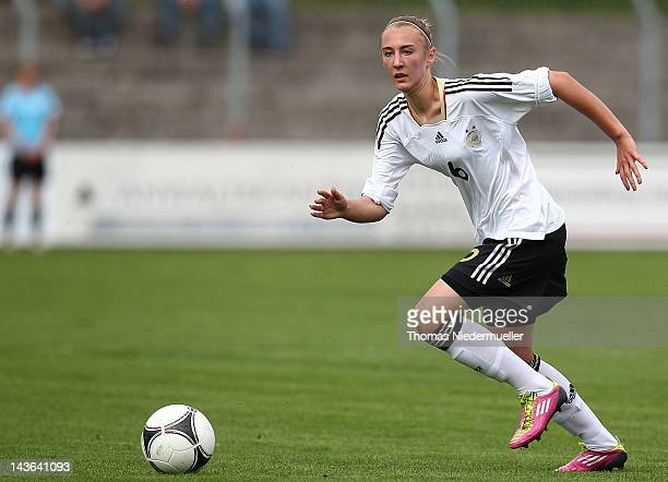 AnnaSophie Fliege runs with the ball during the Girl's International Friendly Under 16 match between Germany and France at HugoKochStadion on May 1...