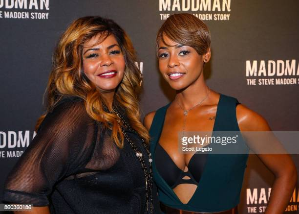 AnnDera Peeples and Actress Erica Peeples pose on red carpet during movie premiere at the Michigan Theater on October 11 2017 in Ann Arbor Michigan