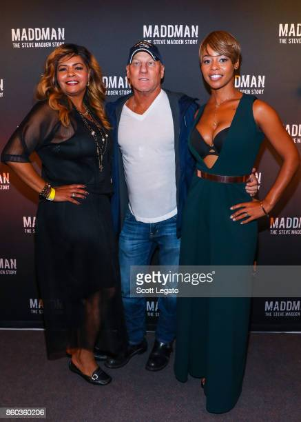 AnnDera Peeples shoe designer Steve Madden and Actress Erica Peeples pose on red carpet during movie premiere at the Michigan Theater on October 11...