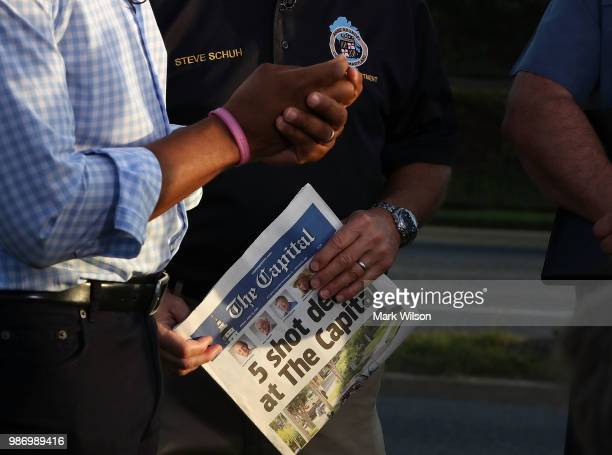 Anne Arundel County Executive Steven Schuh holds today's edition of the Capital Gazette on Thursday on June 289 2018 in Annapolis Maryland 5 people...