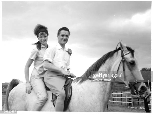 Anne Aubrey and Richard Todd on horseback while on location for the film 'The Hellions' 1961