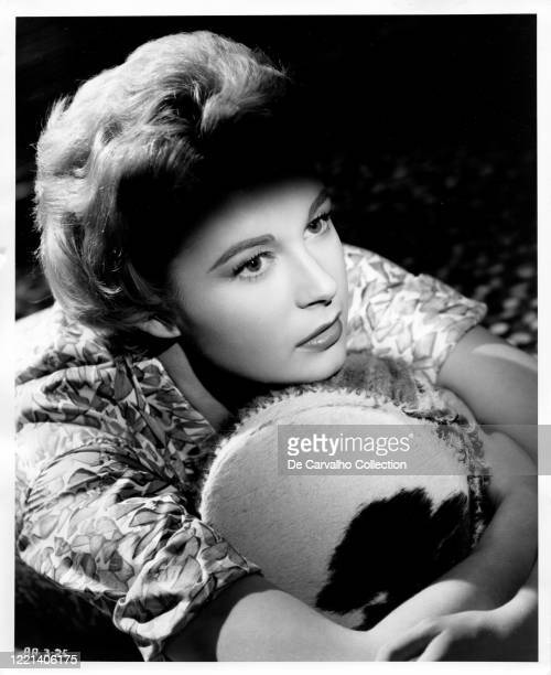 Anne Aubrey as 'Jane Carlton' holding a drum in a publicity shot from the movie 'Killers Of Kilimanjaro' United Kingdom