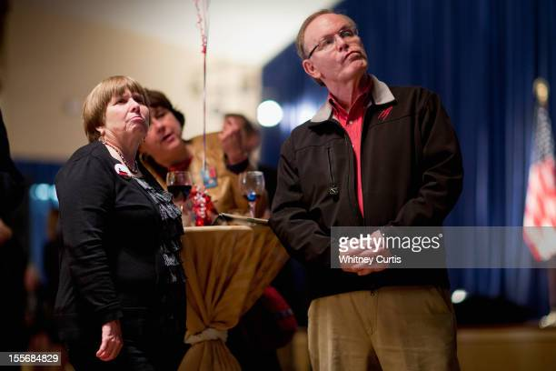 Anne Bader Connie Evans and Jack Bader react to early presidential returns during an election night watch party for US Sen Claire McCaskill November...