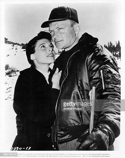 Anne Bancroft looks to Aldo Ray in a scene from the film 'Nightfall' 1957