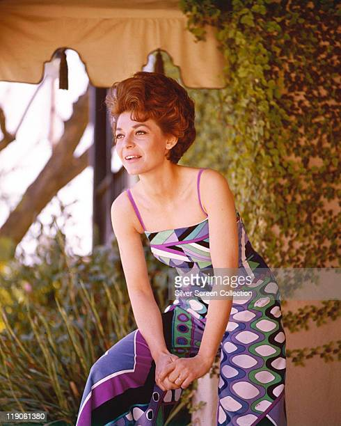 Anne Bancroft US actress wearing a patterned trouser suit circa 1965