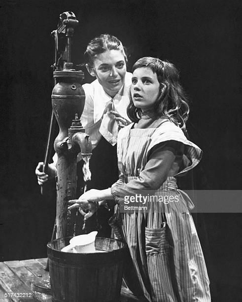 Anne Bancroft washes the hands of Patty Duke during a performance of the William Gibson Broadway play 'The Miracle Worker' circa 1961 They are...
