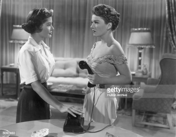 Anne Baxter as Eve Harrington has her telephone call abruptly cut off by Barbara Bates in a scene from the 20th Century Fox film 'All About Eve'...