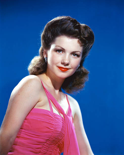 anne-baxter-us-actress-wearing-a-pink-ha