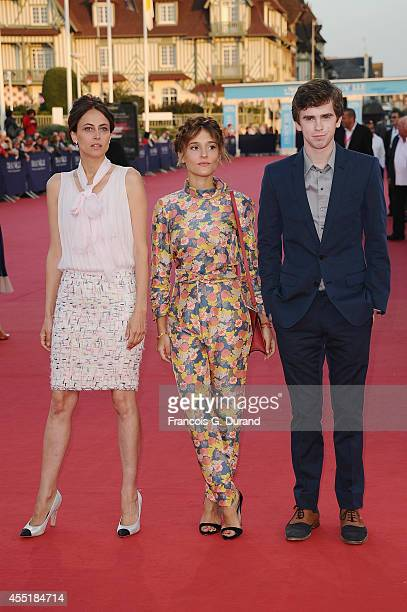 Anne Berest Lola Bessis and Freddie Highmore arrive at the 'Before I Go To Sleep premiere during the 40th Deauville American Film Festival on...
