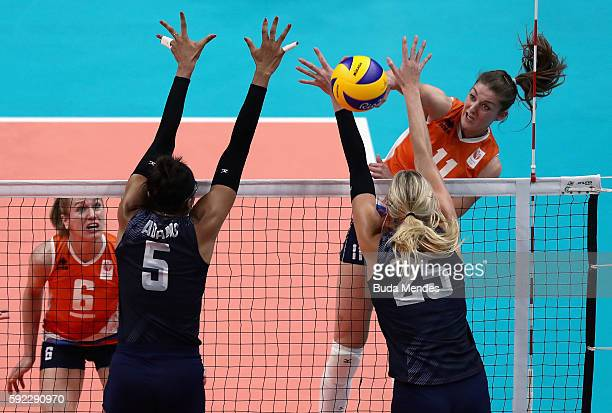 Anne Buijs of Netherlands spikes the ball against Rachael Adams and Karsta Lowe of the United States during the Women's Bronze Medal Match between...