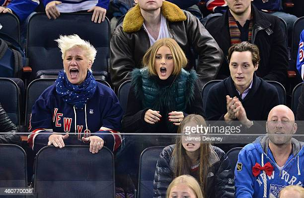 Anne Burrell Olivia Palermo and Grant Palermo attend New York Rangers vs Carolina Hurricanes game at Madison Square Garden on December 21 2014 in New...