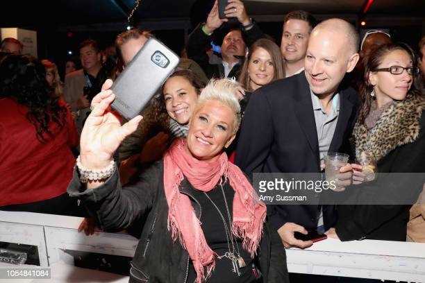 Anne Burrell takes a selfie with guests during Food Network's 25th Birthday Party Celebration at the 11th annual New York City Wine Food Festival at...