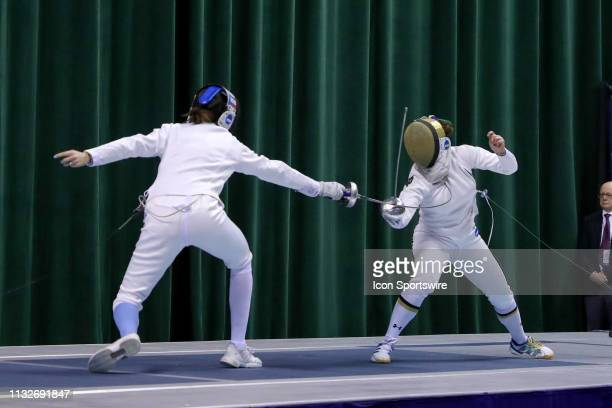Anne Cebula of Columbia and Amanda Sirico of Notre Dame compete in the championship bout of Women's Epee at the National Collegiate Fencing...