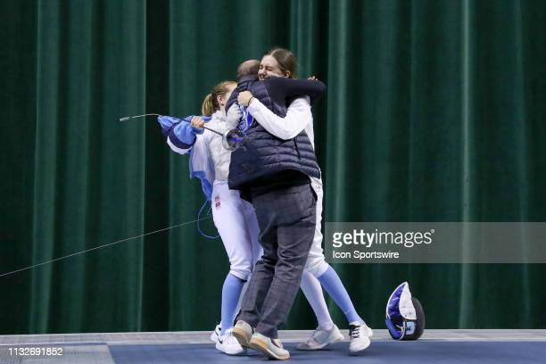 Anne Cebula of Columbia embraces Columbia head coach Michael Aufrichtig after winning the championship in Women's Epee at the National Collegiate...