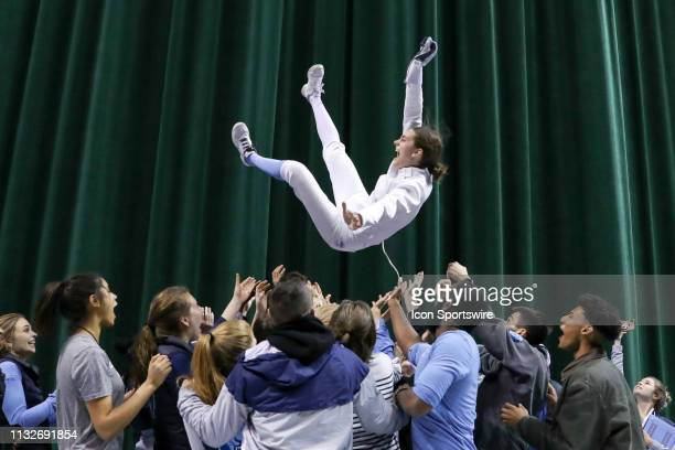 Anne Cebula of Columbia is tossed into the air by her Columbia fencing teammates after winning the championship in Women's Epee at the National...