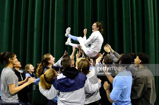 Anne Cebula of the Columbia Lions celebrates her victory in the epee during the Division I Women's Fencing Championship held at The Wolstein Center...
