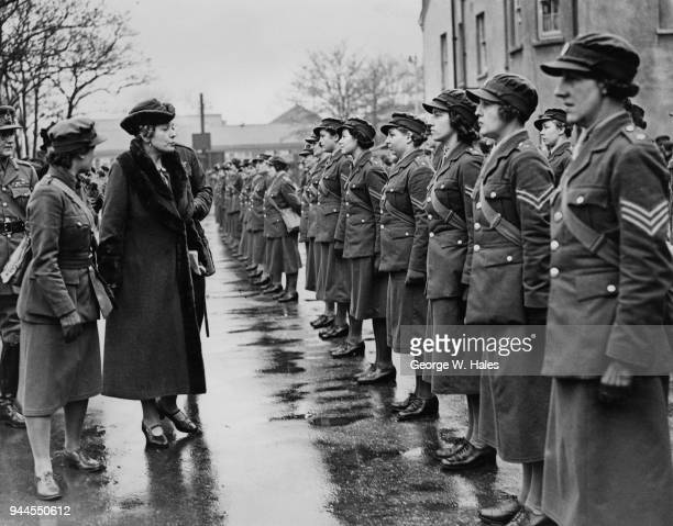 Anne Chamberlain the wife of British Prime Minister Neville Chamberlain inspects members of the ATS during a visit to the Field stores of an Army...