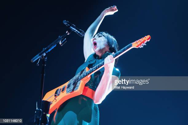 Anne Clark aka St Vincent performs on stage during the Florence and the Machine 'High As Hope' tour at KeyArena on September 10 2018 in Seattle...