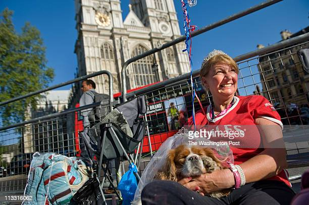 Anne Daley of Wales and her King Charles Spaniel 'Camilla' camp outside the royal wedding venue Westminster Abbey Yes they're both wearing tiaras
