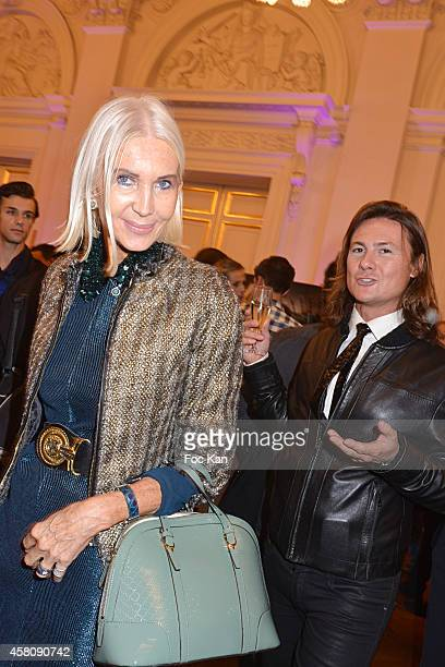 Anne de Champigneul and Sbastien Peiffert attend the Ludovic Baron Photo Exhibition Preview At Palais Brongniart on October 29 2014 in Paris France