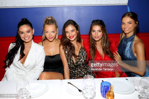 Anne de Paula Camille Kostek Kelsey Merritt Brooks Nader and Robin Holzken attend a Sports Illustrated Swimsuit Event during Miami Swim Week at Amare...