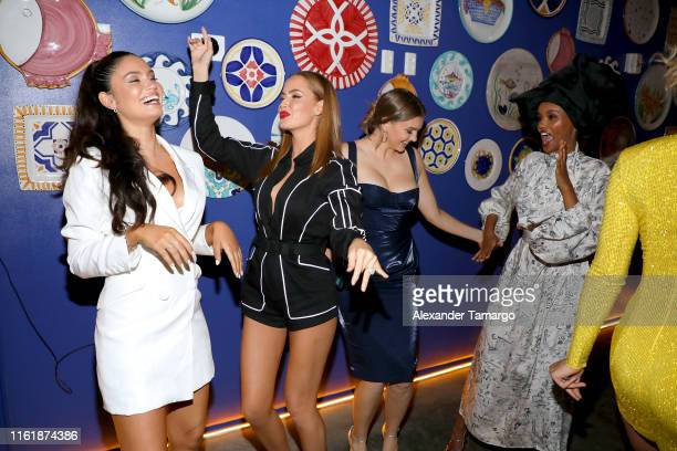 Anne de Paula Haley Kalil and Halima Aden attend a Sports Illustrated Swimsuit Event during Miami Swim Week at Amare Ristorante on July 13 2019 in...