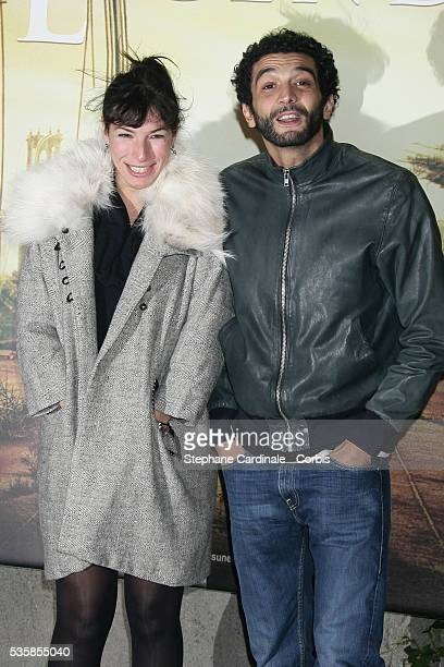 Anne De Petrini and Ramzy Bedia attend the premiere of 'I Am Legend' in Paris