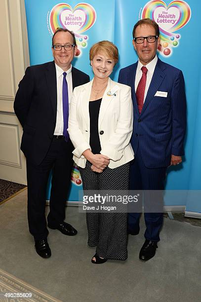 Anne Diamond and Richard Desmond attend the Health Lottery Tea Party at The Savoy on June 2 2014 in London England
