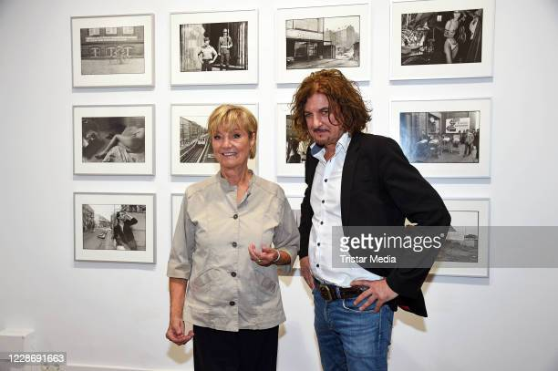 """Anne Dohrenkamp and Andre Kowalski during the """"AENO Malerei und Fotografie - Anne Dohrenkamp and André Kowalski"""" exhibition opening at Hotel Mond..."""