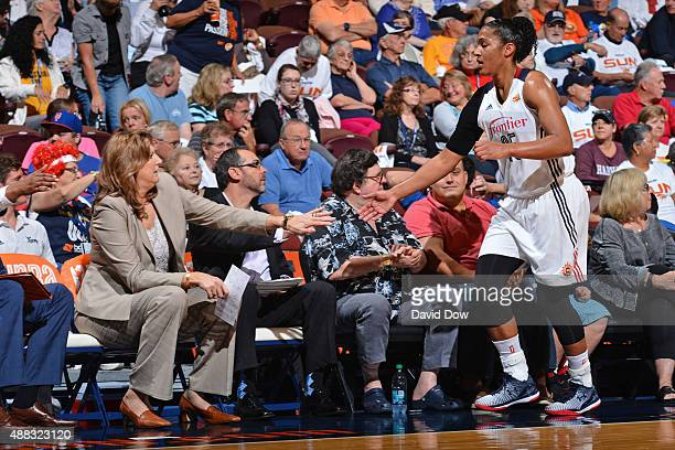 Anne Donovan and Alyssa Thomas of the Connecticut Sun shake hands on the bench against the Chicago Sky on September 13 2015 at the Mohegan Sun Arena...
