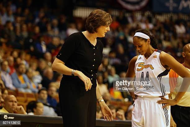 Anne Donovan Head Coach of the Connecticut Sun talks with Ashley Walker during the Connecticut Sun V New York Liberty WNBA pre season game at Mohegan...