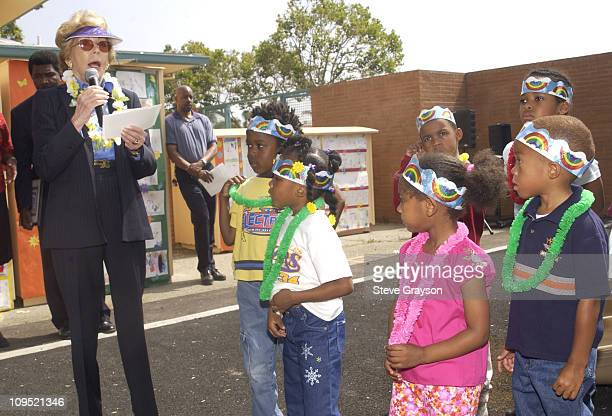Anne Douglas addresses students at LaSalle Avenue School in SouthCentral Los Angeles during the dedication of a playground and equipment donated on...