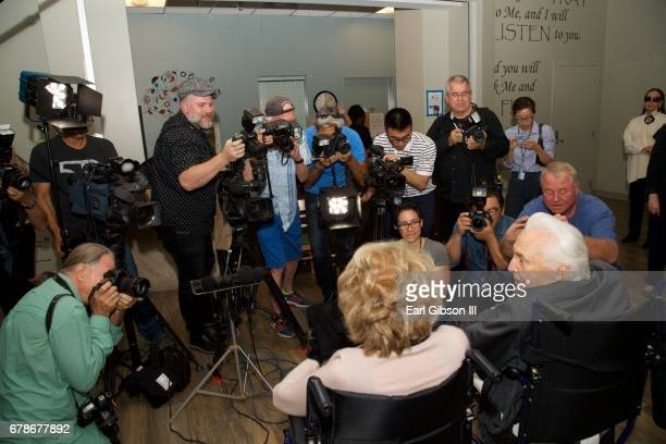Anne Douglas and Kirk Douglas are interviewed by the media as ther arrive for the 25th Anniversary of The Anne Douglas Center at Los Angeles Mission...