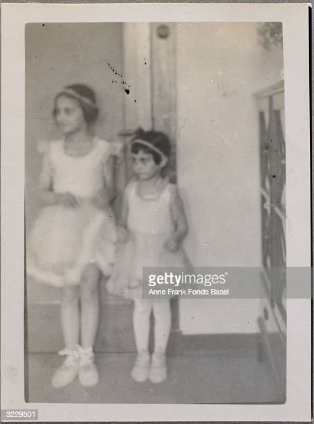 Anne Frank and her sister Margot Frank dressed up in identical outfits for Margot's birthday party Amsterdam the Netherlands February 1934 From Anne...
