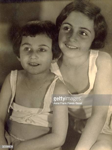 Anne Frank and Margot Frank in undershirts in a portrait from the photo album of Margot Frankfurt Germany