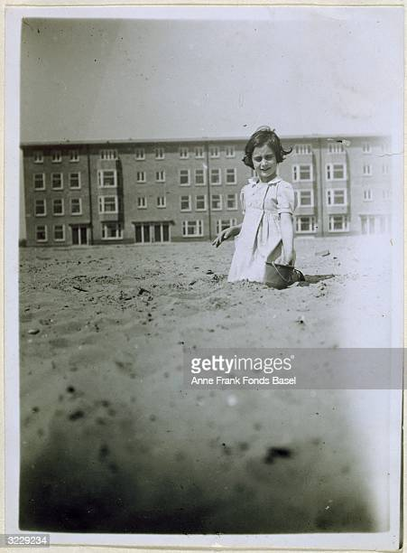 Anne Frank plays in the sand on a beach Amsterdam Holland Taken from her photo album