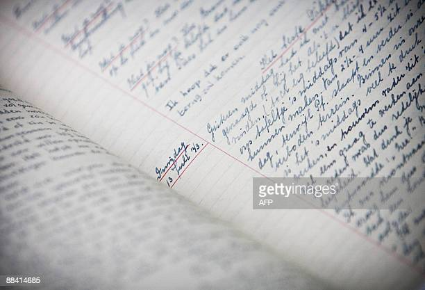 Anne Frank's facsimile diaries are on display during a press conference on June 11 2009 in the Anne Frank museum in Amsterdam on the eve of the 80th...