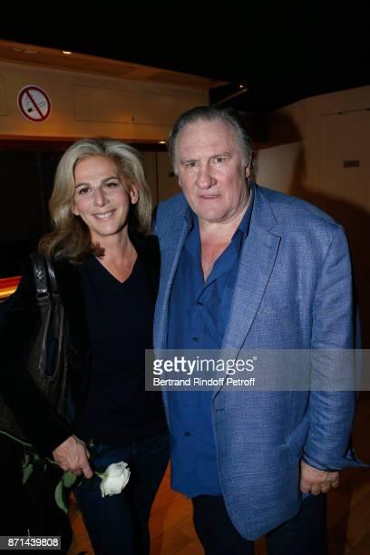 Anne Fulda and Gerard Depardieu pose after 'Depardieu Chante Barbara' at Le Cirque d'Hiver on November 6 2017 in Paris France