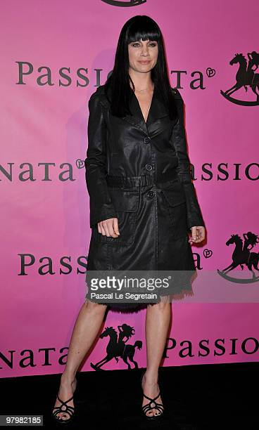 Anne Gaelle Riccio poses during a photocall before the presentation of The Passionata collection on March 23 2010 in Paris France