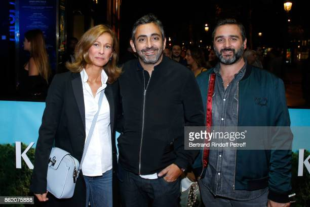 Anne Gravoin Eric Toledano and Olivier Nakache attend the 'Knock' Paris Premiere at Cinema UGC Normandie on October 16 2017 in Paris France