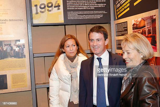 Anne Gravoin her husband French Interior Minister Manuel Valls and former Paris Police chief Martine Monteil attend the 100th Anniversary Of The...